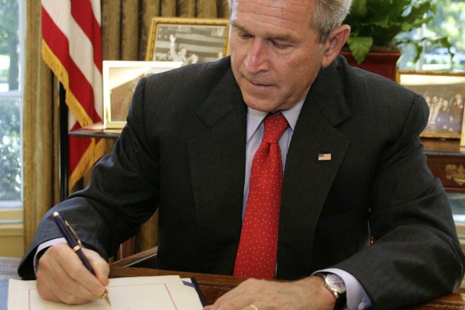 President Bush signs Wall Street bailout bill.