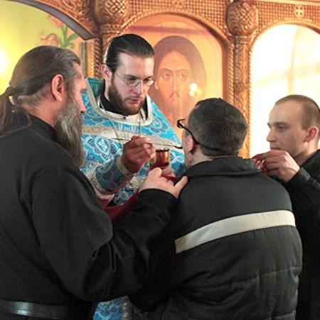 A prisoner receives holy Communion at the Orthodox prison chapel in Nizhny Novgorod, Russia.