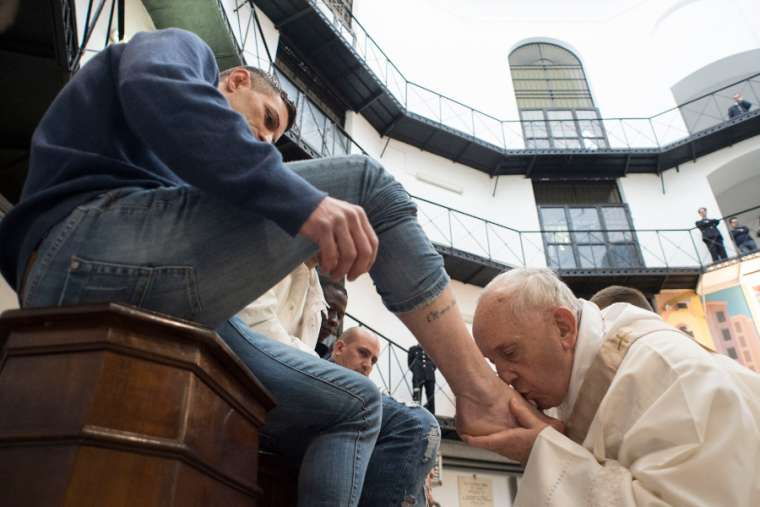 Pope Francis kisses a prisoner's foot at Rome's Regina Coeli Prison March 29.