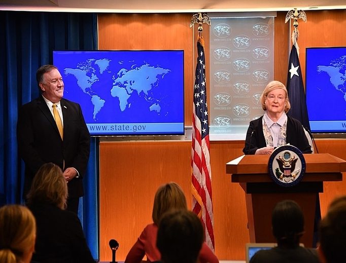 U.S. Secretary of State Michael Pompeo listens to the Chair of the Commission on Unalienable Rights, Mary Ann Glendon, as she delivers remarks to the press at the U.S. Department of State in Washington D.C., July 8, 2019.