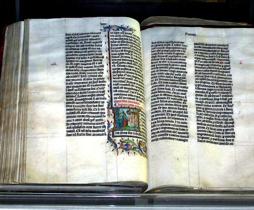 A Bible handwritten in Latin, on display in Malmesbury Abbey, Wiltshire, England. The Bible was written in Belgium in 1407, for reading aloud in a monastery.