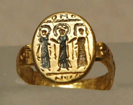 Byzantine wedding ring, depicting Christ uniting the bride and groom, 7th century.