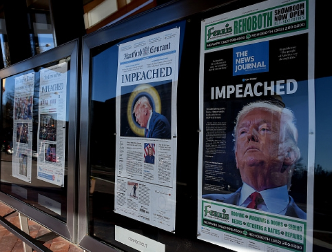 Above, newspaper front pages are on display Dec. 19 at the Newseum in Washington after President Donald Trump's historic Dec. 18 impeachment by the U.S. House of Representatives.