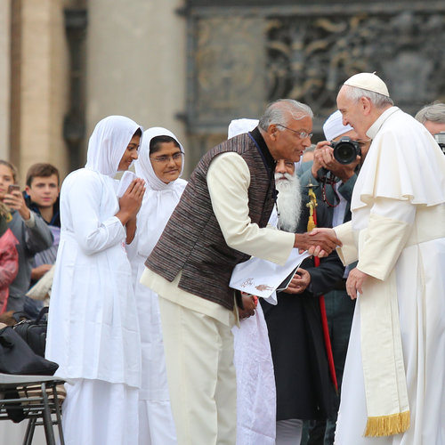 Pope Francis greets an interfaith group in St. Peter's Square for his general audience on Oct. 28, the 50th anniversary of the Second Vatican Council declaration Nostra Aetate, which changed the relationship with people of other faiths.