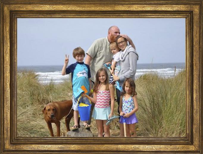 Lizz Lovett with her husband and children.