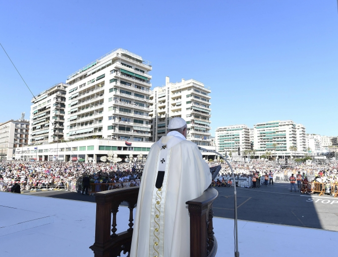 Pope Francis speaks to the crowds gathered during his pastoral visit to the Italian Diocese of Genoa on May 27.