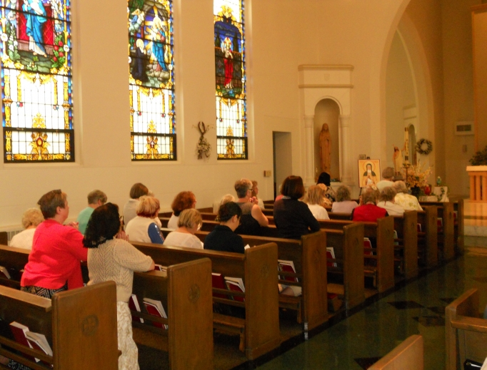 Members of the Avilas pray a Holy Hour in the chapel of St. Mary Seminary in the Diocese of Cleveland.