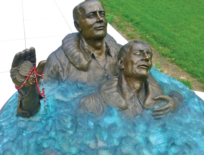 Above, a statue in Waterbury, Connecticut, depicts Father Thomas Conway in the ocean aiding a drowning sailor after the USS Indianapolis was torpedoed in 1945. Also below: Father Thomas Conway celebrates Mass aboard ship. A prayer card, shown below, offers devotion for the beloved chaplain's eternal rest. The chaplain was awarded various medals, also shown, for his valor.