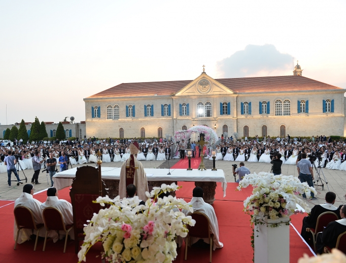 Lebanese Cardinal Bechara Rai, patriarch of Maronite Catholics, celebrates a wedding Mass for 41 couples Sept. 2 at Berke, the Maronite patriarchate north of Beirut.  Since the first collective wedding in 2009, a total of 240 couples have been married.