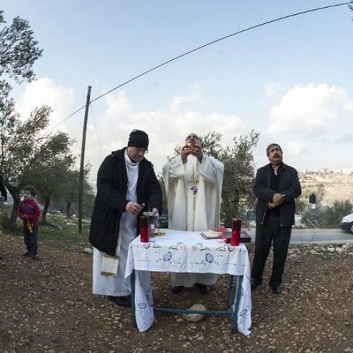 Mass being celebrated at the proposed site of an Israeli security wall in the West Bank's Cremisan Valley on Jan. 17, 2014.
