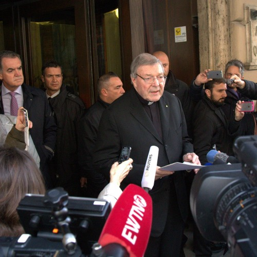 Cardinal George Pell meets with child sex abuse victims at the Hotel Quirinale in Rome on March 3, 2016.