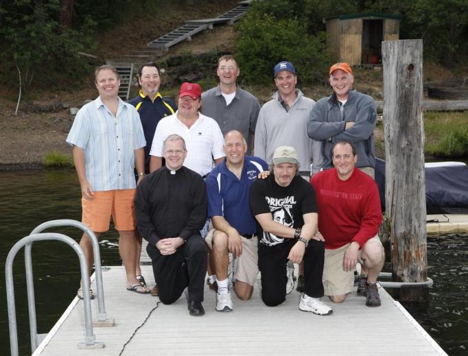Back row, from left to right: Mike Konesky, Bill Akers, Patrick Shultheis, Mark Mengert, Chris Ammann and Brian Dennehy. Front row, from left to right: Father Sean Raftis, Joey Tambari, Joe Caferro and Rick Bruya.