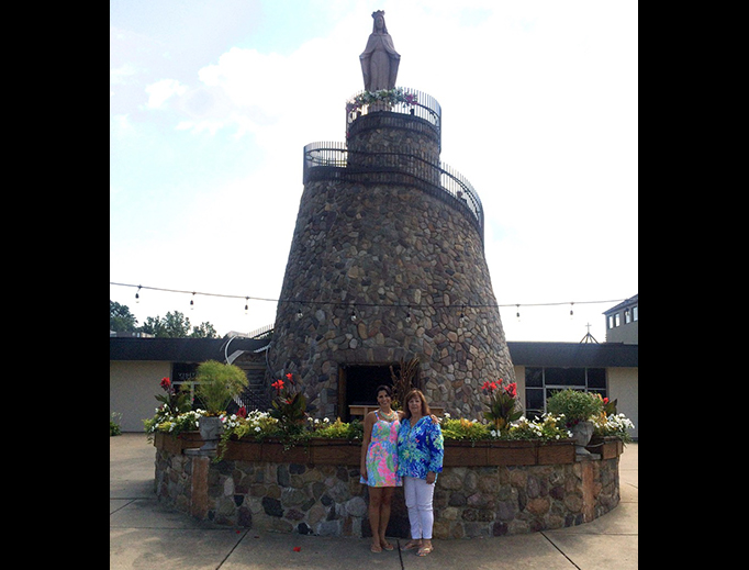 Julie-Ann Sageer and her mother, Hinded, visit the Basilica and National Shrine of Our Lady of Lebanon in North Jackson, Ohio, during Assumption celebrations last Aug. 15.