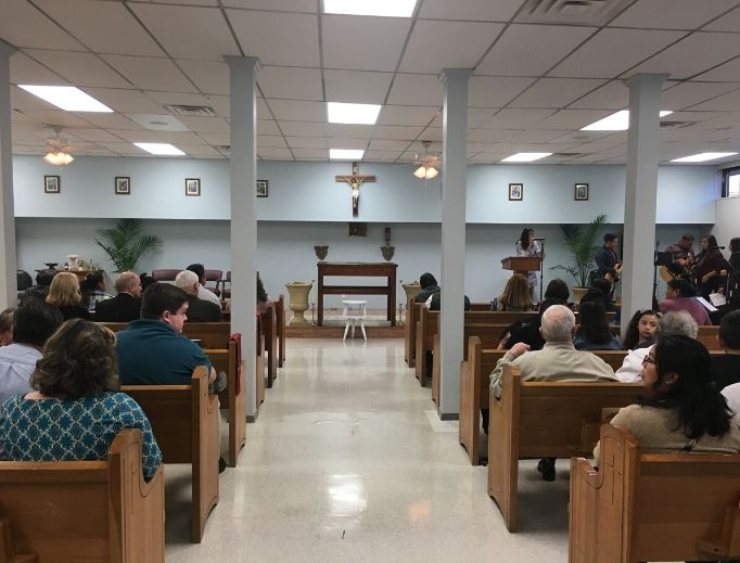 Above, the day of dedication of Sts. Peter and Paul in Lincoln, Arkansas, in October 2018 gathered parishioners and Catholic locals to celebrate the new small parish.