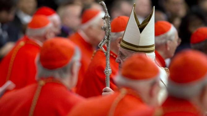 Pope Francis walks among cardinals on Feb. 14