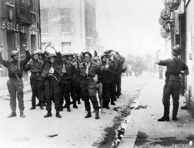 Canadian prisoners of war being led through Dieppe by German soldiers.