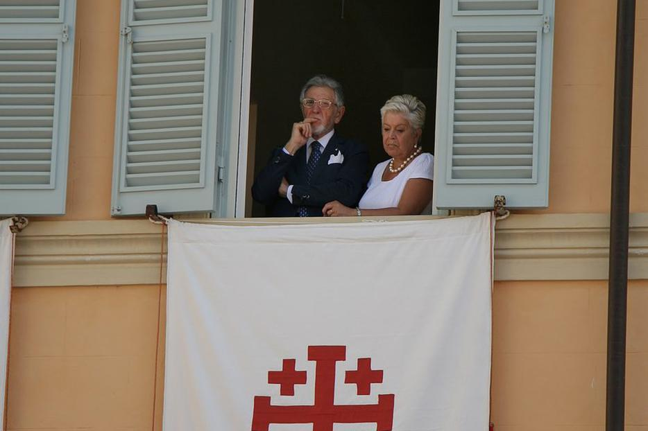 Onlookers observe the crowds at last year's Mass on the Feast of the Assumption at Castel Gandolfo.