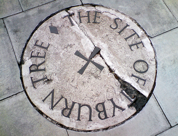 The stone commemorating the Tyburn site on the traffic island at the junction of Edgware Road and Marble Arch in London.