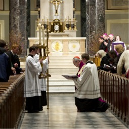 PENITENTIAL SERVICE. Cardinal Justin Rigali, kneeling at right, leads the Stations of Cross at the Cathedral Basilica of SS. Peter and Paul March 11. The penitential service was called by the cardinal in response to the clergy sexual abuse crisis.