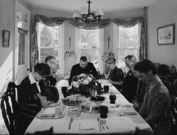 Saying grace before carving the turkey at Thanksgiving dinner in the home of Earle Landis in Neffsville, Pennsylvania, in November 1942.