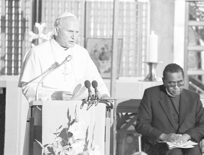 Above,  Pope John Paul II speaks at the World Council of Churches June 12, 1984, as Rev. Dr. Philip Potter, general secretary of the council, listens. John Paul II encouraged the 'common search for the one truth.' His trip was the second visit by the head of the Catholic Church to the Geneva headquarters of the fellowship of churches. Pope Paul VI visited the WCC in June 1969. Shown below, Paul VI arrives at WCC headquarters, surrounded by Eugene C. Blake, WCC general secretary, and other church dignitaries.