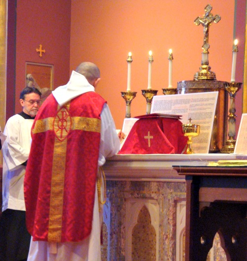 A priest faces 'ad orientem' during Mass in the chapel of the Cathedral of the Holy Cross in Boston.