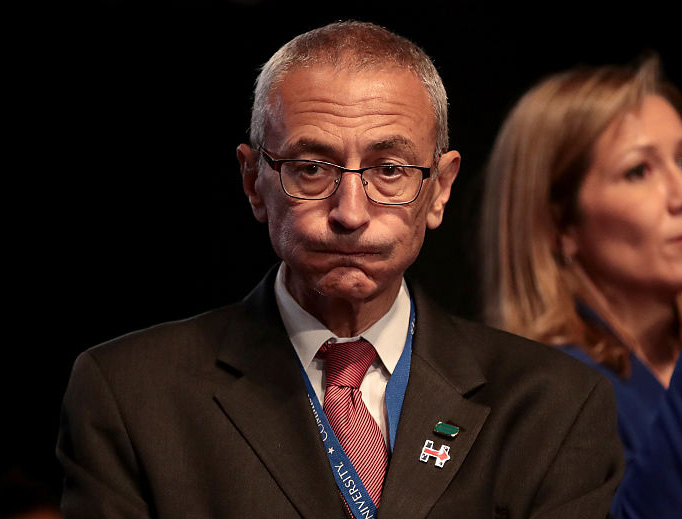 Democratic presidential nominee Hillary Clinton's Campaign Chairman John Podesta looks on prior to the start of the Presidential Debate at Hofstra University on September 26, 2016 in Hempstead, New York.