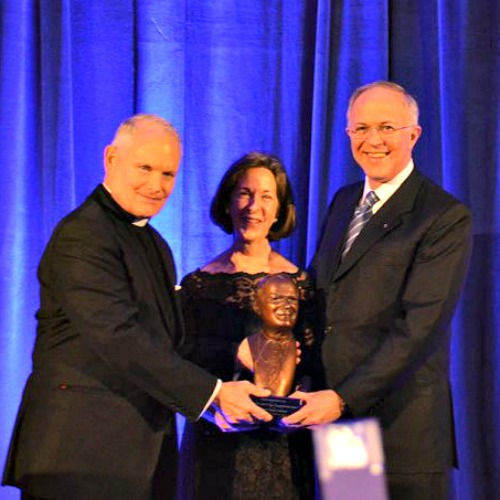 Father Arne Panula presents Carl and Dorian Anderson with the St. John Paul II Award for the New Evangelization Oct. 29 in Washington.
