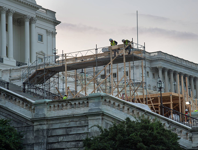 Construction crews prepare the platform at the U.S. Capitol for Donald J. Trump's inauguration on Jan. 20, 2017.
