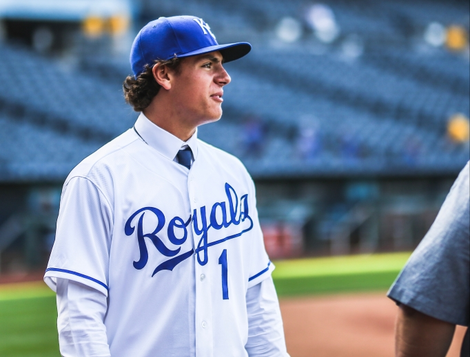 Above, Nick Pratto dons a Royals uniform. Below, Mike Sweeney (left) and Nick Pratto (right).