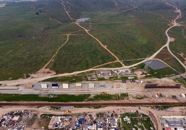 Aerial view of the wall prototypes (c) and the new second line fencing (r) at the U.S.-Mexico border, as seen from Tijuana, Baja California state, Mexico, Feb. 26. Last week, the U.S. Department of Customs and Border Protection said President Donald Trump's border-wall prototypes are going to be torn down to make way for a second barrier separating California and Mexico.