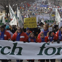 March for Life participants make their way up Constitution Avenue to the Supreme Court building in Washington Jan. 24. The annual pro-life demonstration marks the 1973 Supreme Court decision that legalized abortion across the nation.