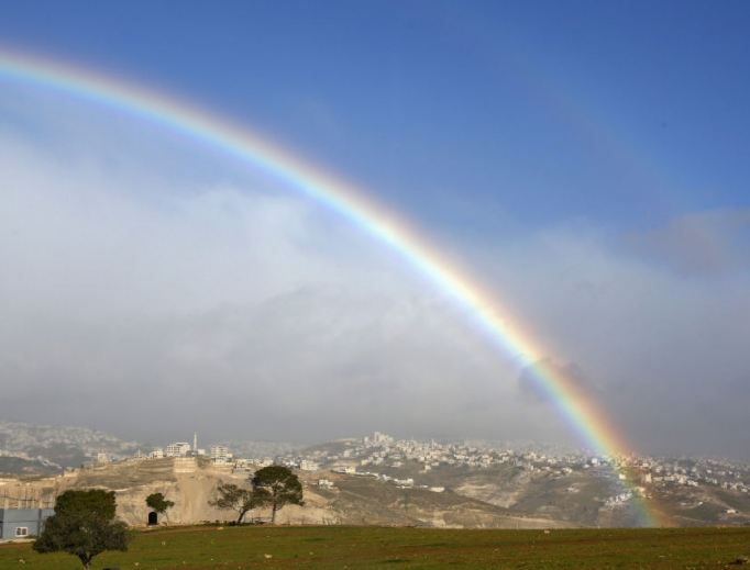A picture taken Jan. 31 shows a rainbow over the Palestinian village of Abu Dis in the West Bank. U.S. President Donald Trump unveiled his plan for the Middle East Jan. 28, recognizing disputed Jerusalem as Israel's 'undivided' capital but acknowledging the Palestinians' desire for a capital in 'eastern Jerusalem' and said it could be established in Abu Dis, a Palestinian village adjacent to Jerusalem that is physically separated by an Israeli barrier.