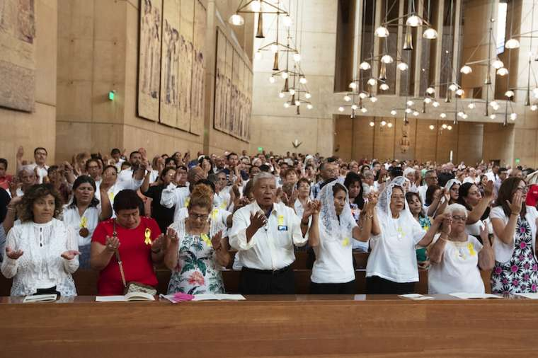 Faithful pray at the Sept. 7 Mass in recognition of all immigrants at the Cathedral of Our Lady of the Angels in Los Angeles.