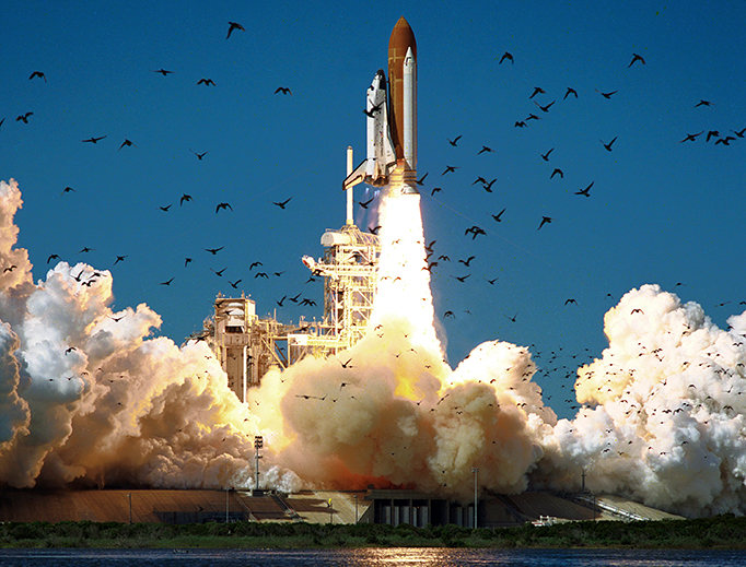 Space Shuttle Challenger launches from launchpad 39B at the start of its final flight, Jan. 28, 1986.