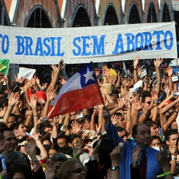 Faithful hold a banner in Portuguese, meaning 'Brazil without abortion' as Pope Benedict XVI presides over Mass opening the 5th general meeting of the Latin American bishops' conference in Aparecida, Brazil, in 2007.