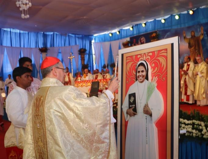 Above, Cardinal Angelo Amato blesses a portrait of Blessed Rani Maria Vattalil Nov. 4. Below, Cardinal Telesphore Toppo greets Sister Rani's killer, Samandar Singh.
