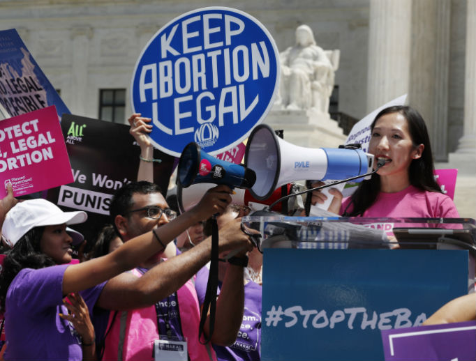 Leana Wen, president of Planned Parenthood, speaks during a protest against abortion bans May 21 outside the Supreme Court in Washington. A coalition of dozens of groups held a 'National Day of Action to Stop the Bans,' with other events planned throughout the week.