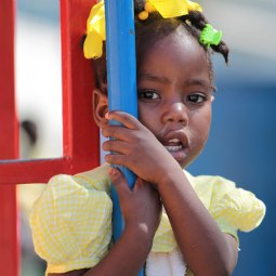 A girl clings to a pole during a break in classes at the Salesian-run National School of Arts and Vocations in Port-au-Prince, Haiti, March 14. The school's mission continues despite the loss of lives and damages it suffered in the January 2010 earthquake.