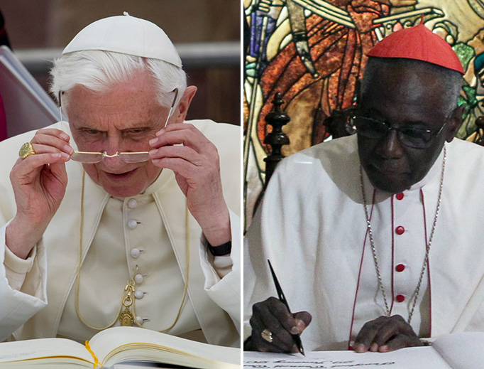 LEFT: Benedict XVI puts on his glasses to sign a guest book in Freiburg, Germany, Sept. 24, 2011. (Sebastien Bozon/AFP via Getty Images). RIGHT: Cardinal Robert Sarah signs a guest book at the Malacañan Palace in the Philippines, Jan. 29, 2014. (Photo by Gil Nartea/Malacañang Photo Bureau/Public Domain via Wikimedia Commons).