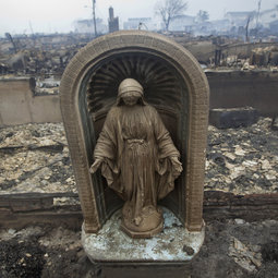 A statue is seen among homes devastated by fire and the effects of Hurricane Sandy in the Breezy Point section of the Queens borough of New York Oct. 30. Millions of people across the eastern United States awoke on Tuesday to scenes of destruction wrought by monster storm Sandy, which knocked out power to huge swathes of the nation's most densely populated region, swamped New York's subway system and submerged streets in Manhattan's financial district.
