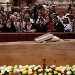 PILGRIM POPE. Pilgrims venerate the casket of Blessed Pope John Paul II in front of the main altar in St. Peter's Basilica at the Vatican May 2. The Vatican said 250,000 people passed by to pay their respects following the pope's May 1 beatification.