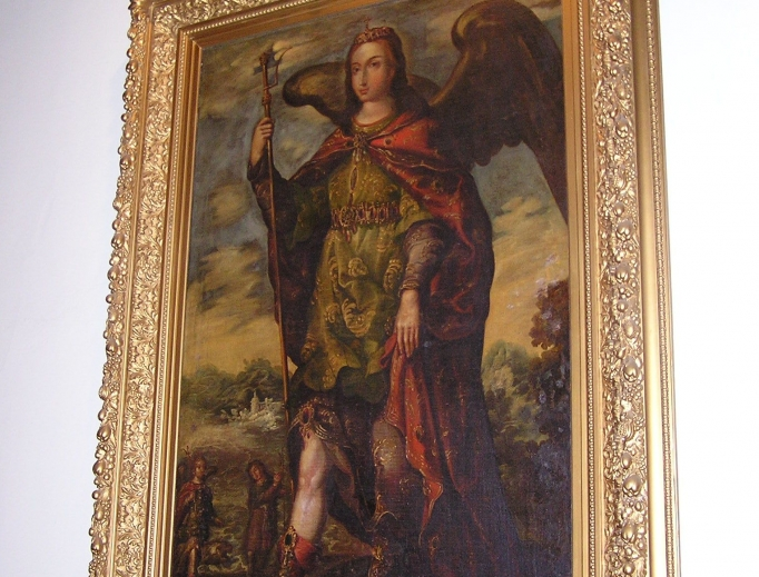 In the cathedral entrance hangs a large painting of the cathedral's patron, St. Raphael the Archangel. The wood decor and statues create a prayerful atmosphere in the oldest parish in Iowa