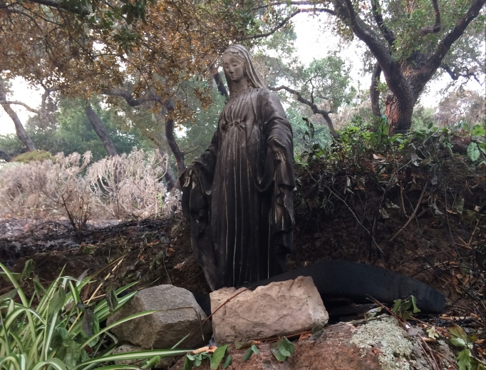 Above, the burned Blessed Mother statue on the Omlin property; below, the fire line is shown, along with other burned acreage.