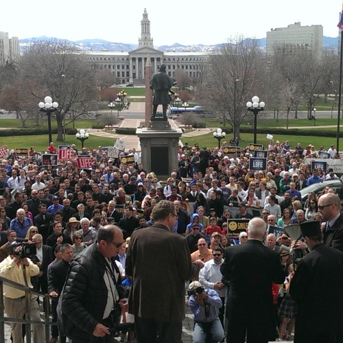Archbishop Samuel Aquila of Denver leads an April 15 prayer rally at the Colorado Capitol.