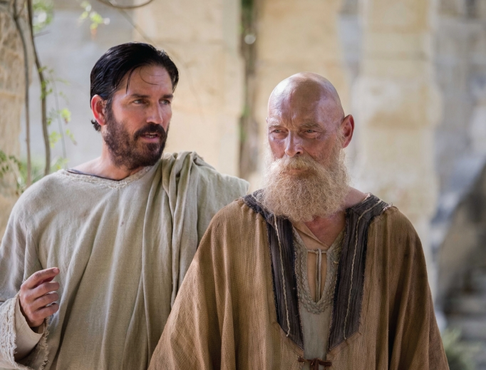 Jim Caviezel (l) portrays St. Luke in Paul, Apostle of Christ, which also stars James Faulkner (r) in the title role.