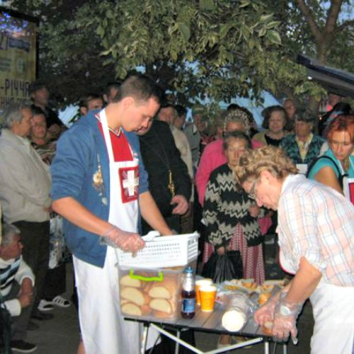 Volunteers distribute food to Ukrainians displaced from their homes by the violence.
