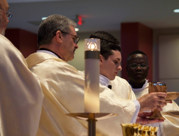 Above, Deacon Carlos Garcia and his son Father Michael Garcia have a special connection in the Church.