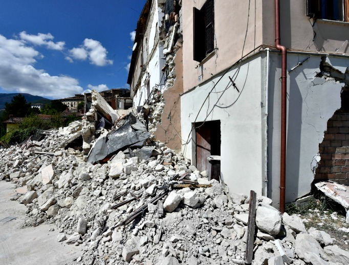 Rubble surrounds a damaged building on Aug. 24 in Accumoli, Italy. Central Italy was struck by a powerful, 6.2-magnitude earthquake in the early hours, which has killed at least three people and devastated dozens of mountain villages.
