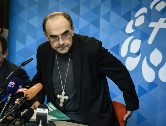 Cardinal Philippe Barbarin of Lyon, Francis, departs a news conference March 7 in Lyon, during which he announced that he will resign at a meeting with Pope Francis March 18, following his conviction for failing to report the sex abuse of minors by one of his priests.